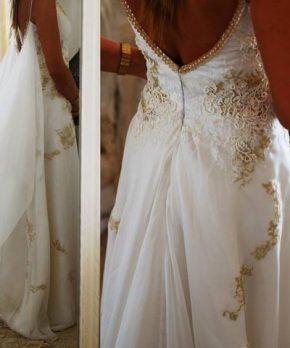 Vestido usado de novia con espalda rebajada y detalles de perlas